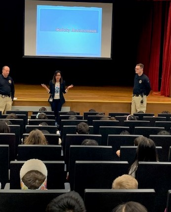 POP officers and Ms. Tsonis present Safety Awareness Assemblies