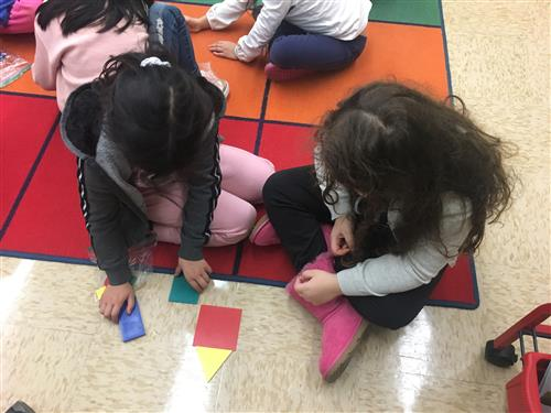 students using math tiles