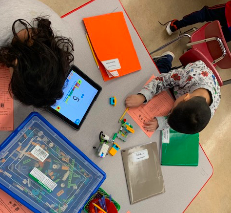 students programming with WeDo Kits