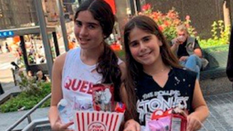 Sisters Danielle, left, and Rebecca Apfelbaum, who attend Great Neck North Middle School, have been