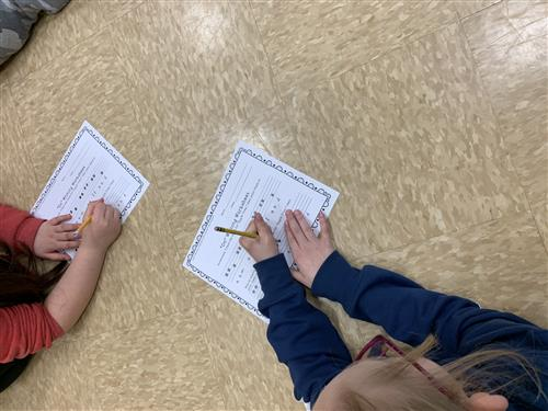 Students completing a music worksheet