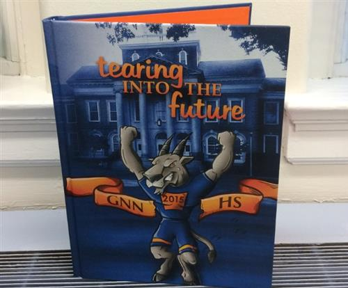 "Image of yearbook with title ""tearing into the future, GNN HS 2015"""