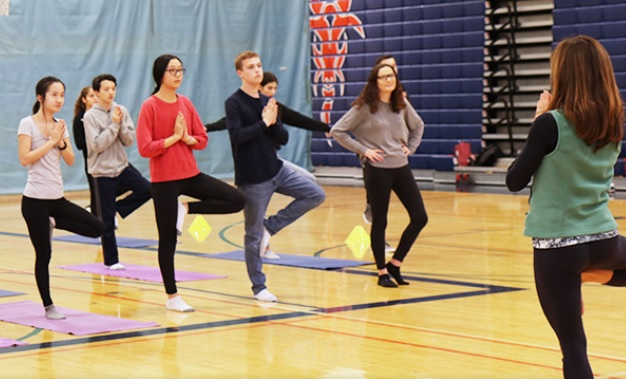 Image of North High students doing yoga