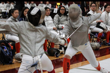 two fencing students