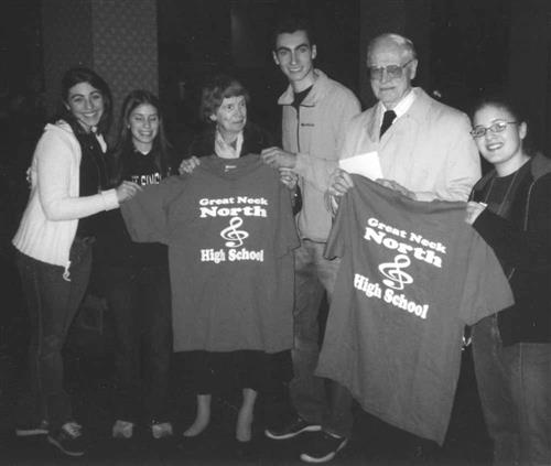 Mr. and Mrs. Ritter with North High Students displaying GNNHS T-Shirts