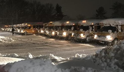 Bus parking lot covered in snow