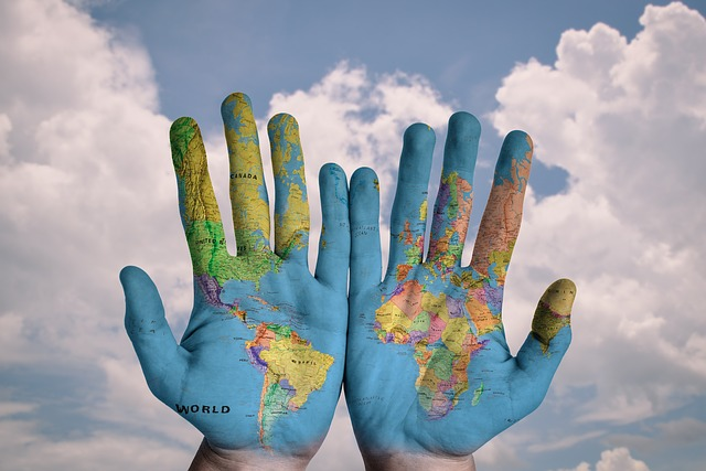 image of hands with world globe painted on it