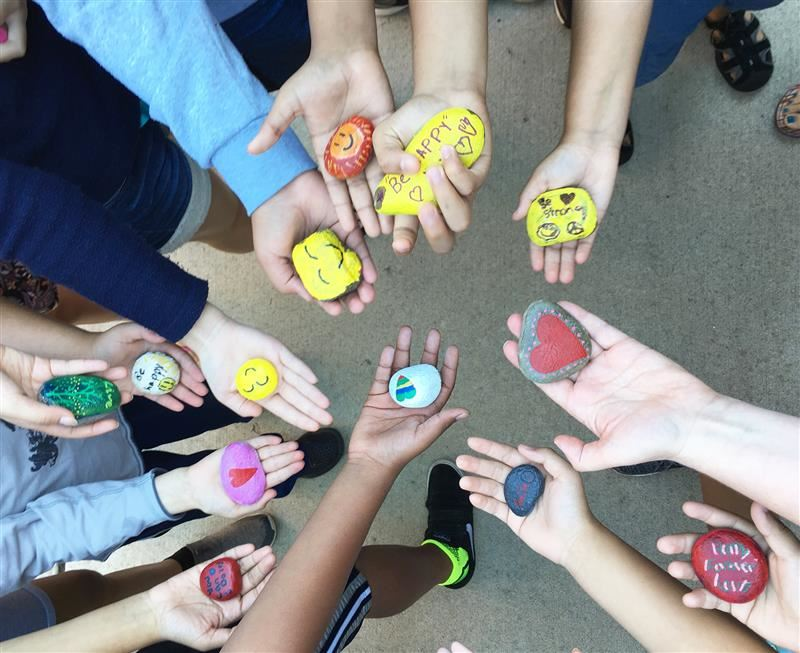 Hand-painted rocks for a kindness project