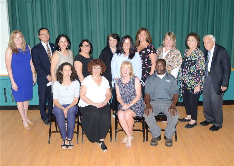 25-Year employees are photographed with Board of Education trustees and the Superintendent.