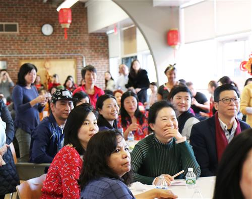 Audience members enjoy performances during the ALC Lunar New Year Celebration