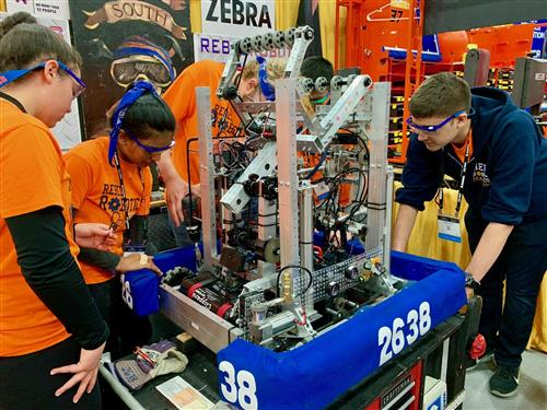 South High Robotics team members work on their robot at the FIRST World Championship in Detroit.