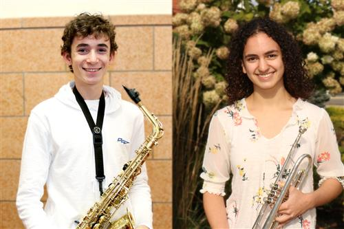 Scott Levy from North High and Sophia Wotman from South High are photographed with their instruments