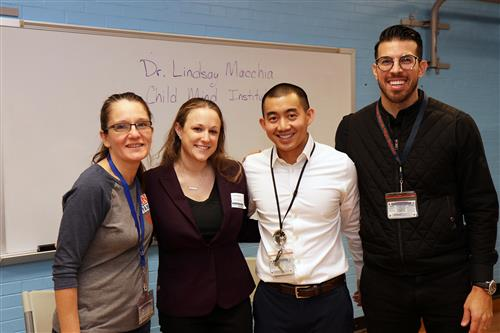 Dr. Lindsay Macchia of the Child Mind Institute is photographed with North High shcool psychologists and social worker.
