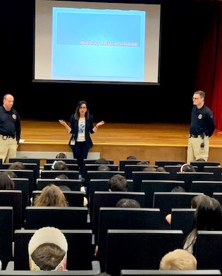 Presenters discuss safety measures to an audience of young students