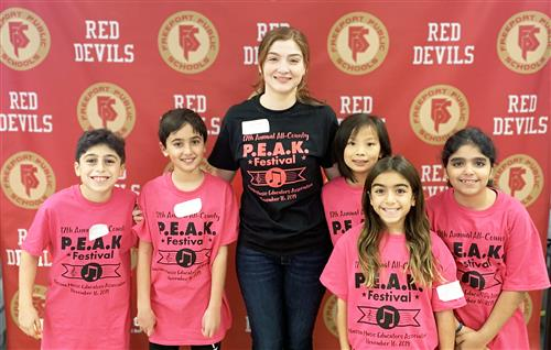 Music teacher Allie Lambraia is photographed with five Kennedy fourth graders at the PEAK Festival