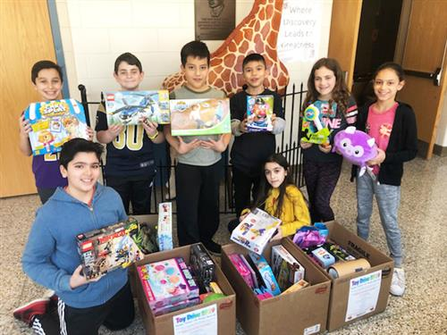 JFK students hold toys that were collected for local children's hospitals