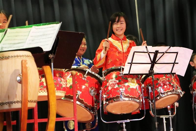 A Lakeville School fifth graders performs on Chinese drums during the Lunar New Year celebration.