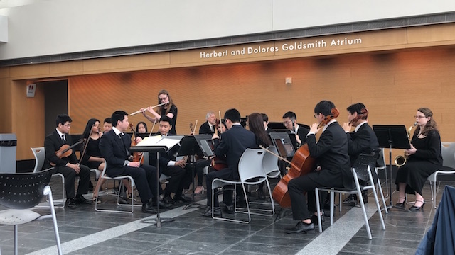 Sixteen student musicians perform in the Atrium at the Tilles Center