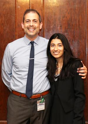North High Principal Dan Holtzman congratulates award winner Preethi Kumar.