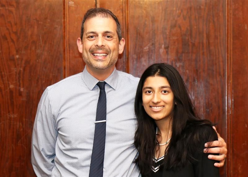 North High School junior Preethi Kumar is congratulated by Principal Daniel Holtzman.