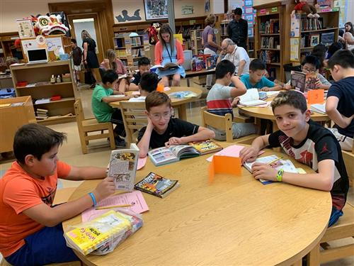 Saddle Rock students reading books in the school library as part of the Read-a-Thon.