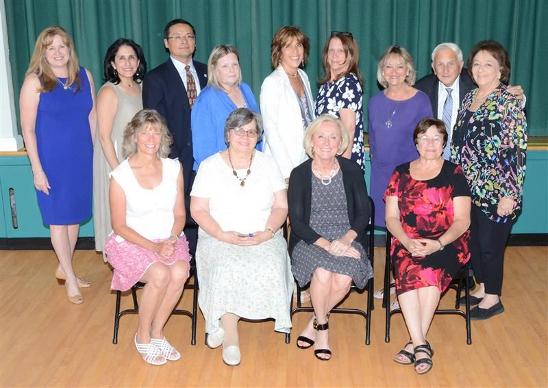 Retirees are photographed with Board of Education trustees and the Superintendent.