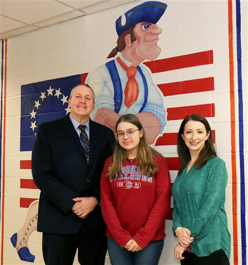 Caroline Papadelis is congratulated by South High Principal Dr. Christopher Gitz and guidance counselor Carly Bank.
