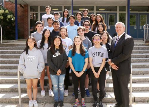 Twelve National Merit Scholarship Semifinalists with their building principal, Dr. Gitz.