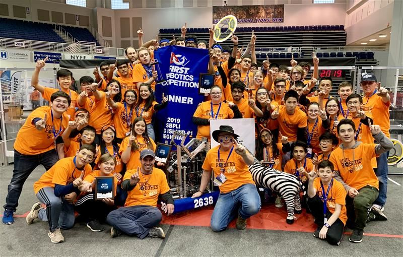 The South High Robotics Team takes a celebratory group photo after winning the SBPLI regional.