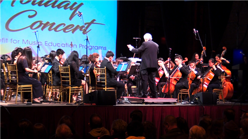 North High musicians perform on stage at the LIMHoF Concert under the direction of Joseph Rutkowski