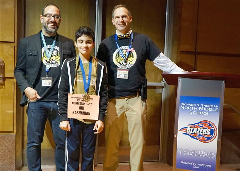 Winner Ari Kashanian is pictured with English teacher Mr. Del Ferraro and Principal Dr. Cozine