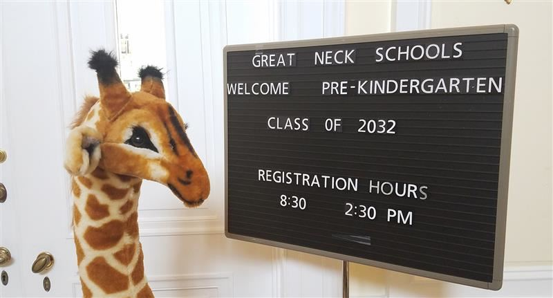 sign for prekindergarten registration in the district administration building