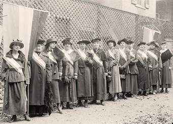 Women in formal attire in line for work