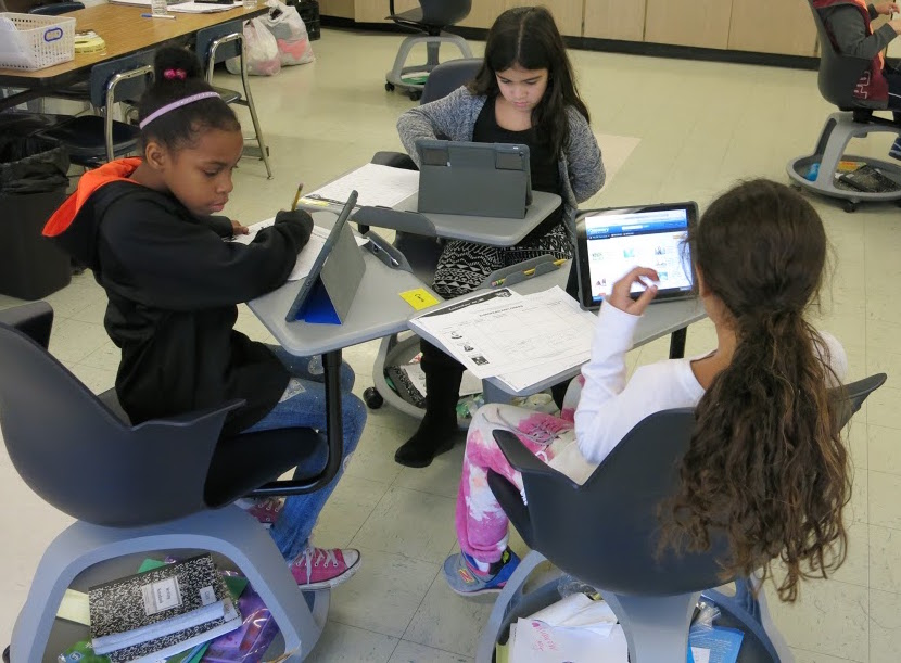Image of Three Kennedy Students on Node Chairs using iPads