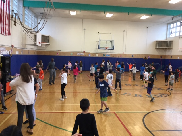 students jumping rope in gym