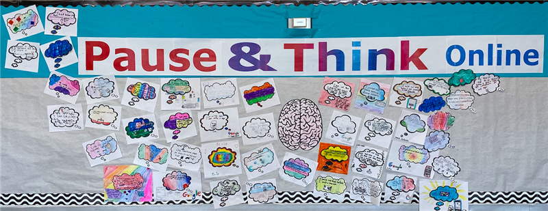 Bulletin board with thought bubbles expressing how students will pause and think online